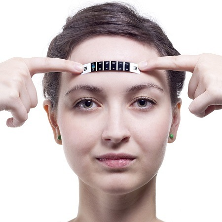 Woman Holding Forehead Strip Thermometer